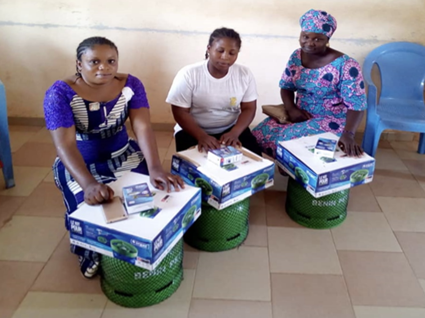 Women beneficiaries receiving gas kits